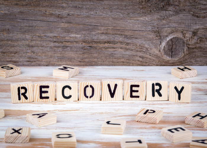 RECOVERY spelled out on Scrabble blocks